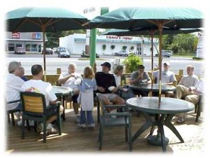 Customers of SweetBerries enjoying frozen custard on the patio.