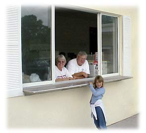 Customers of SweetBerries getting frozen custard from the service window.