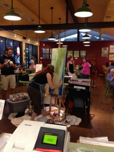Sarah Whitmire paints at SweetBerries during Art Walk Gainesville